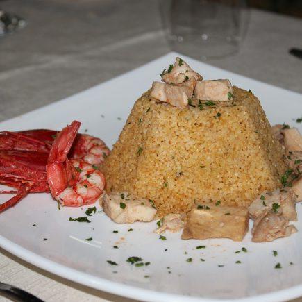 Le fameux couscous algérien: un délice pour vos papilles.